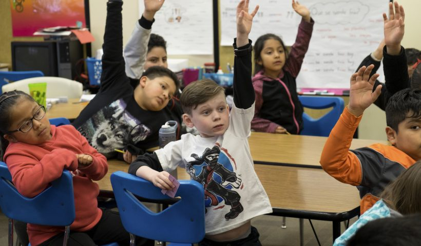 Children Raising their hands